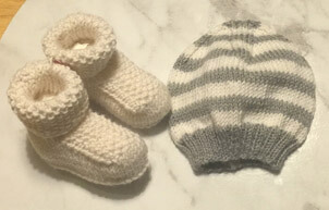knitted booties and beanie